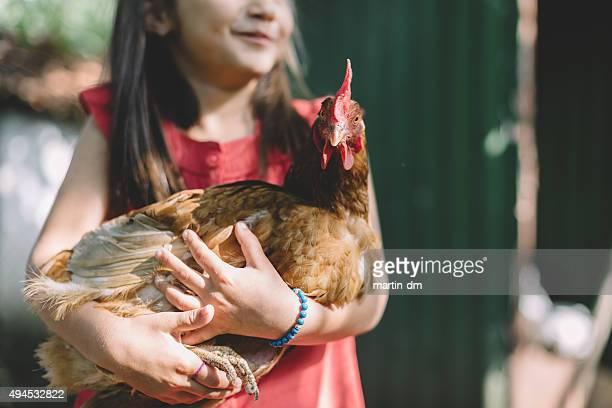 Farmer Mädchen mit hen