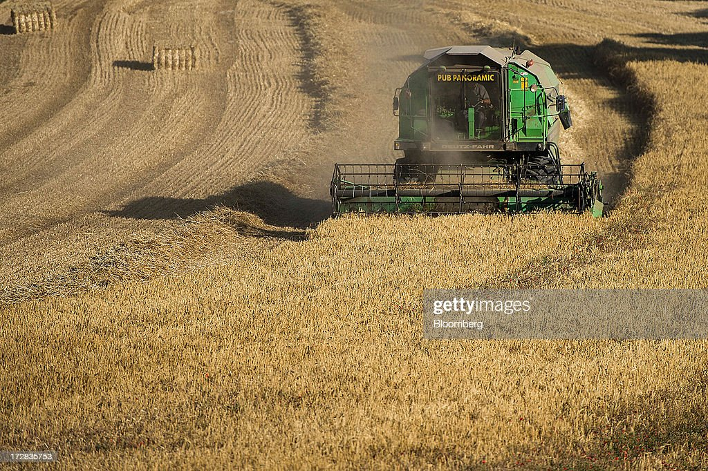 A farmer harvests barley using a Deutz-Fahr combine harvester in Cervera, Spain, on Thursday, July 4, 2013. Spain consumes about 28 million to 30 million tons of grain a year, of which two-thirds is produced domestically, according to young farmers organization Asaja. Photographer: David Ramos/Bloomberg via Getty Images