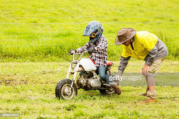 Farmer Helping Bogged Learner Trail Bike Rider on a Farm