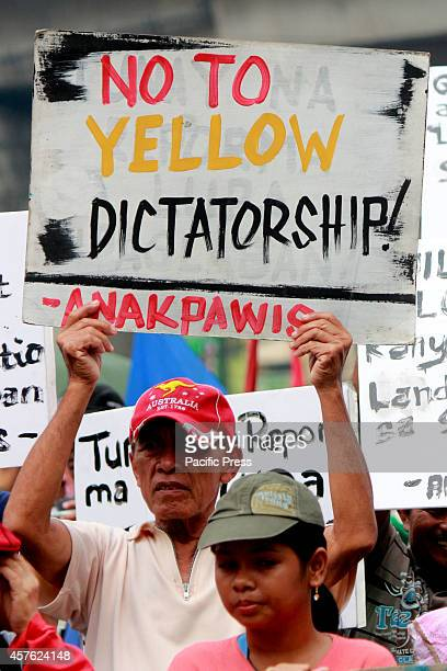 Farmer holding a placard that they are against in yellow dictatorship Farmers led by militant peasant group Kilusang Magbubukid ng Pilipinas marched...