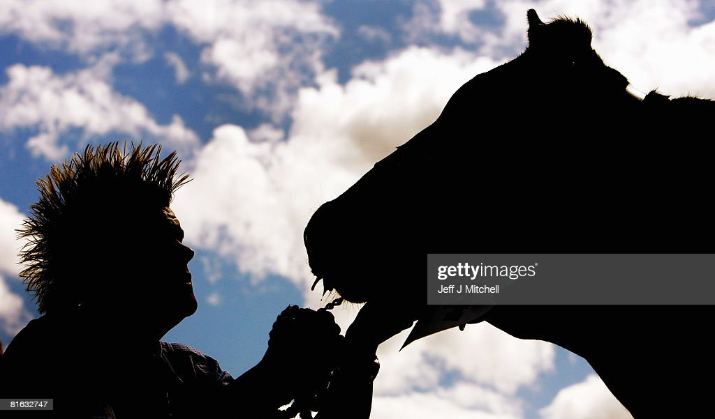 A farmer holds his cow, at the Royal Highland Show June 19, 2008 in Edinburgh, Scotland. The event is the biggest in the Scottish farming calendar with it expecting over 100,000 visitors over the next four day's.