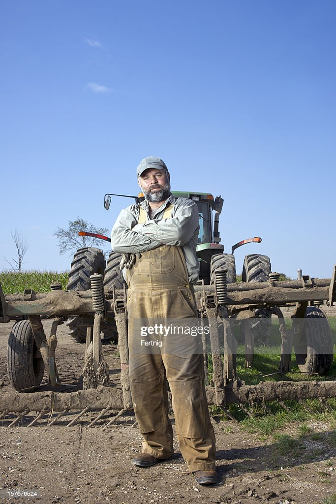 Farmer in his field with a plow : Stock Photo