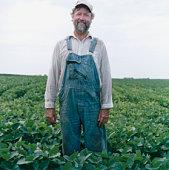 Farmer in Soybean Field