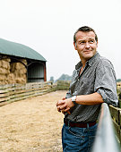 Farmer Leaning on a Gate in a Paddock