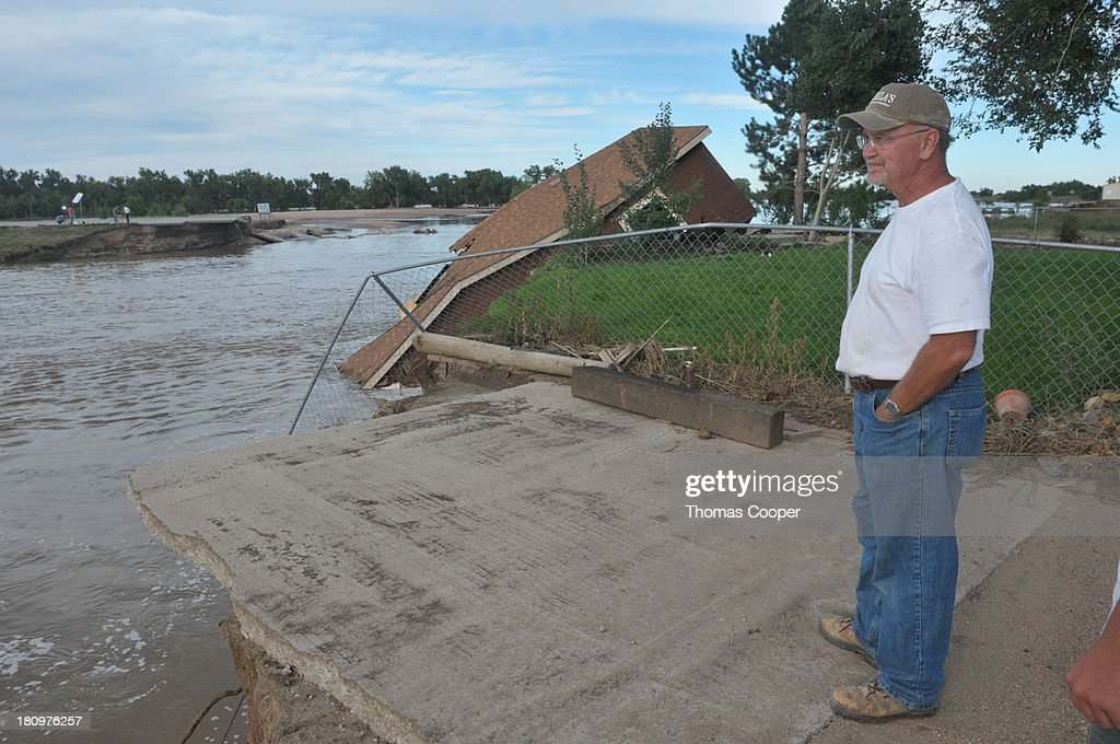 A farmer looks over the South Platte River, which claimed the home of his hired hand September 17, 2013 near Evans, in eastern Colorado. Even as flooding subsides, many in the hardest hit areas of the state remain stranded by washed out roads and rushing creeks and without water and power.