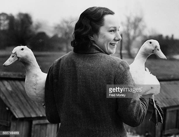 Farmer Nancy Melville holding two of the Aylesbury ducks which she raises on Bury Farm near Chesham in Buckinghamshire 14th March 1942