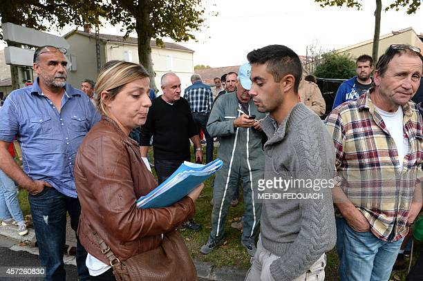 Farmer Nicolas Magne speaks with his lawyer Sophie Lagarde prior to turning himself in at the gendarmerie of VilleneuvesurLot southern France on...