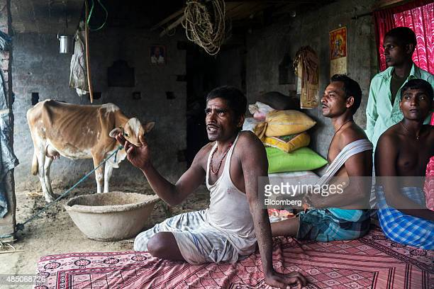 Farmer Nishibi Rai center speaks during an interview at his home in Raghopur Bihar India on Friday July 24 2015 More than anywhere Bihar reflects the...