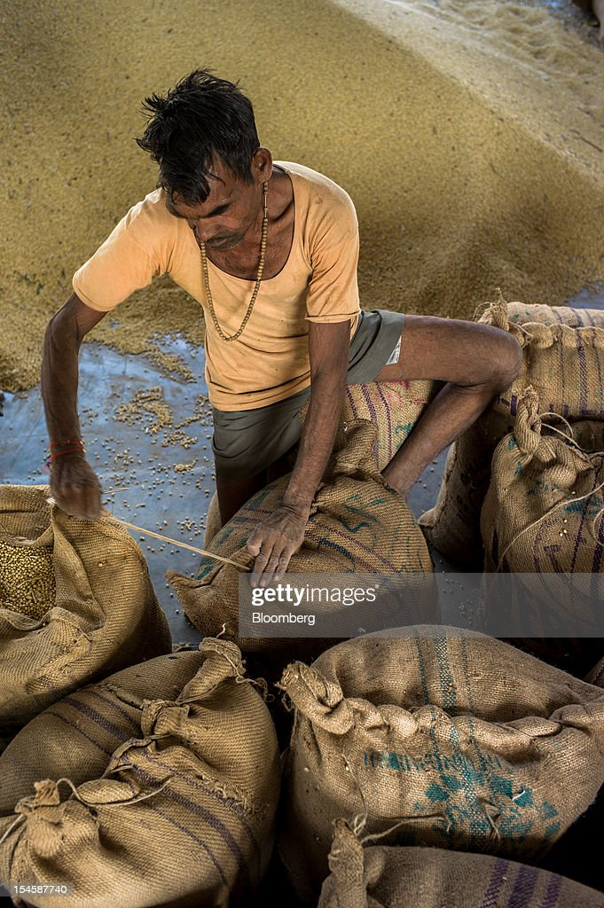 A farmer packs his soybeans in gunny sacks to be sold at a grain market in Burhanpur, Madhya Pradesh, India, on Friday, Oct. 19, 2012. Global soybean consumption will drop about 3 million metric tons in 2012-2013 as record prices curb demand for the oil made from the oilseed for food and biofuel, Thomas Mielke, executive director of Oil World, said. Photographer: Sanjit Das/Bloomberg via Getty Images