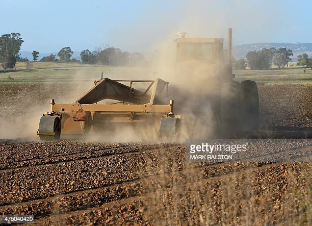 A farmer ploughs his dusty field in Sheldon as a severe drought continues to affect California on May 25 2015 California has recently announced...