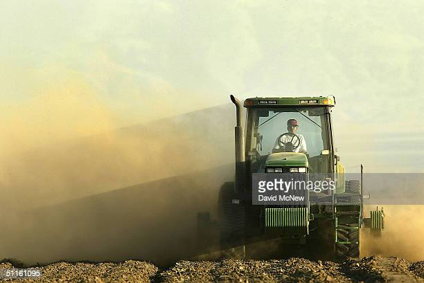 A farmer plows a field on August 11 2004 near the town of Arvin southeast of Bakersfield California Californias Central Valley is one of the nation's...
