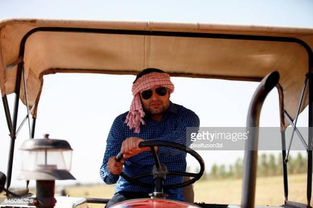 Farmer portrait while driving tractor