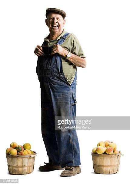 Farmer posing with baskets of apricots