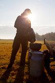 Farmer pouring milk