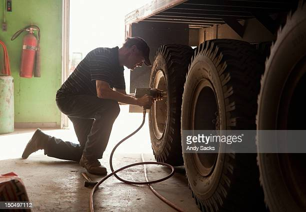 A farmer prepares a truck for harvest work