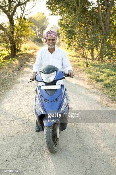 Farmer riding motorcycle
