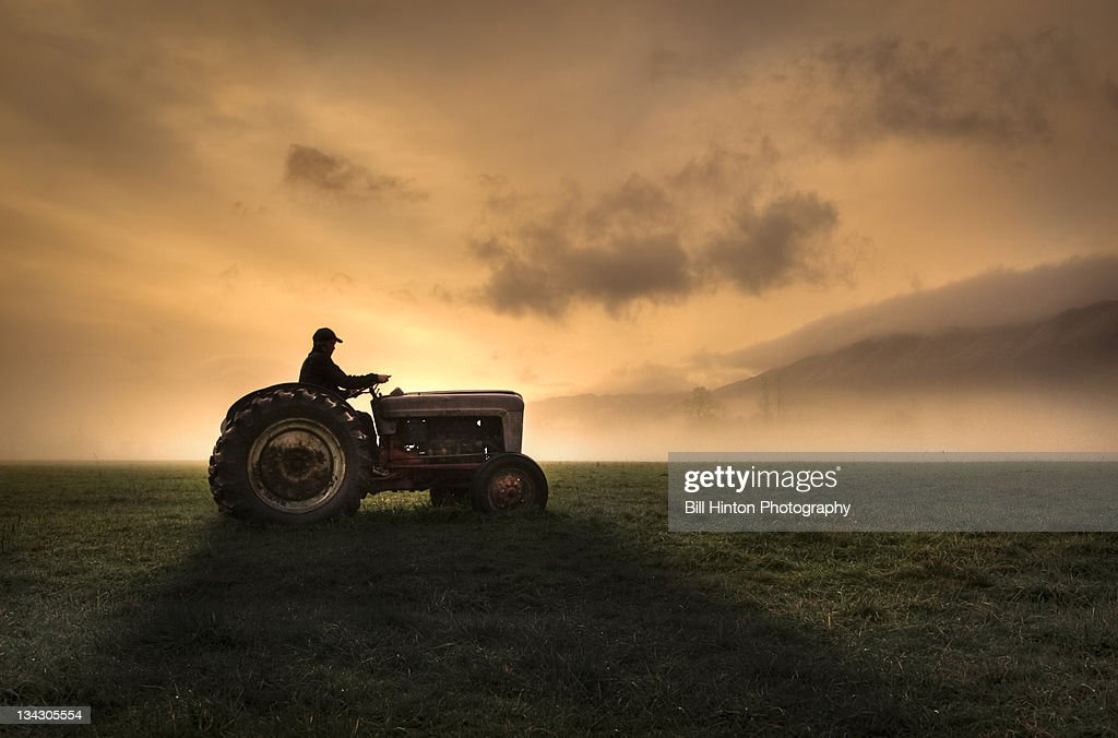 Farmer Riding Tractor Stock Photo | Getty Images