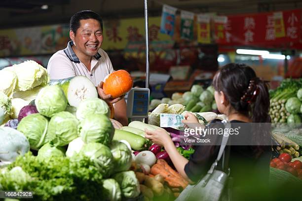 Farmer selling vegetables in food market