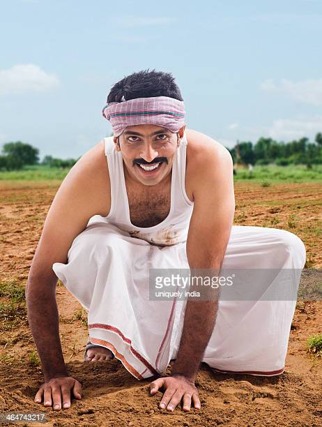 Farmer sowing a seed in a field