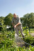 Farmer spraying garden