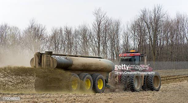 Farmer Spreading Liquid Manure