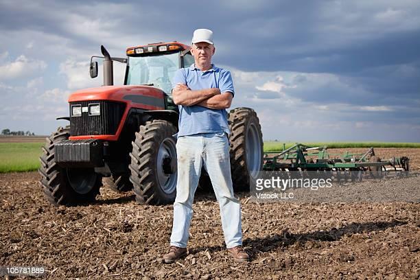 Farmer standing in field