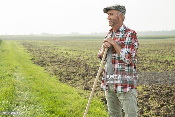 Farmer standing in front of a field