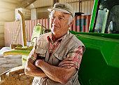 Farmer standing near tractor