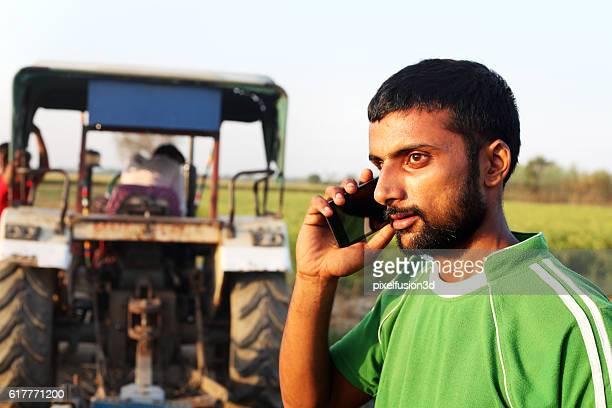Farmer talking on smart phone