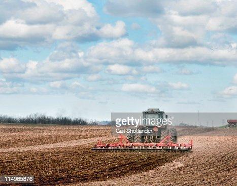 Farmer tilling field