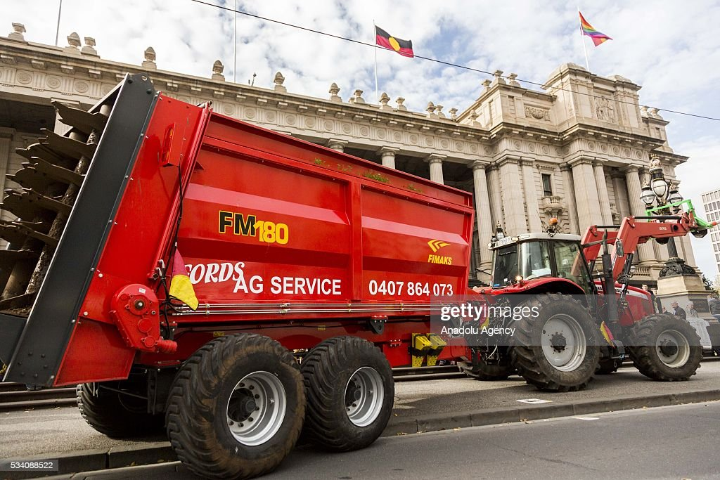A farmer tractor parks in front of the Parliament House during a protest demanding Australian government to solve the dairy crisis in Melbourne, Australia on May 25, 2016.