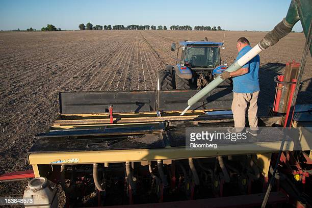 A farmer unloads fertilizer before applying it to a field during corn planting in Rojas Argentina on Monday Oct 7 2013 Argentina accounts for 18...