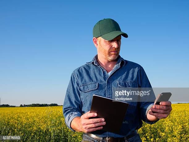 Farmer using a Computer and Phone