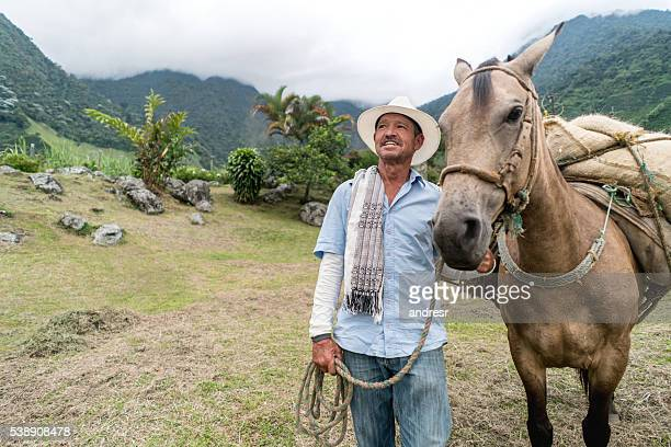 Farmer using a donkey at the farm
