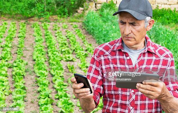 Farmer using tablet and smart phone