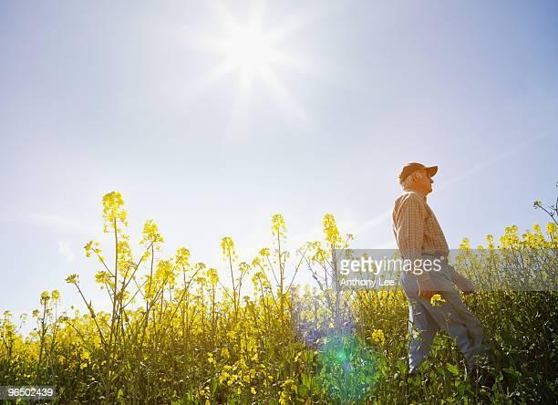 Farmer walking through field