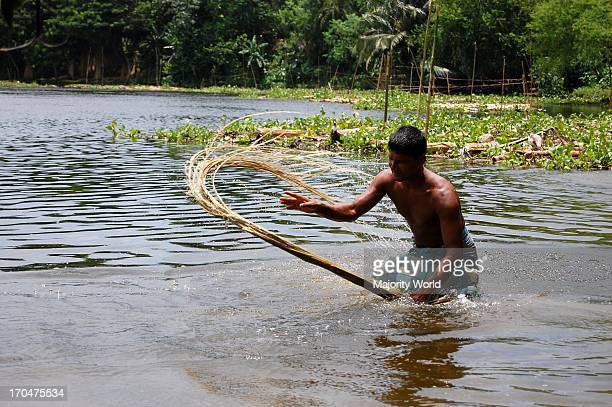 A farmer washing jute in a marsh in Narail Jessore Bangladesh Eighty percent of the world's high quality jute grows in Bangladesh Jute is used in...