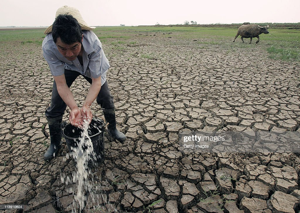 A farmer waters the field on May 9, 2011 in Wuhan, Hubei Province of China. Farmers in most parts of central and southern China are worried about the harvest after seeing one of the driest springs on previous records.