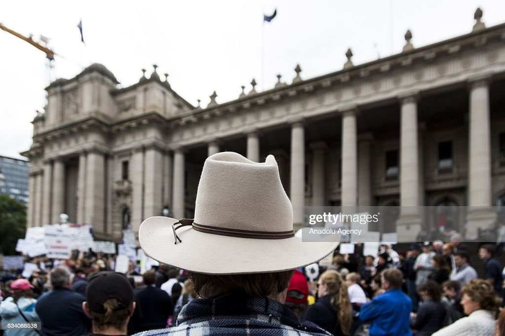 A farmer wearing a cowboy hat listens the speech outside the Parliament House during a protest demanding Australian government to solve the dairy crisis in Melbourne, Australia on May 25, 2016.