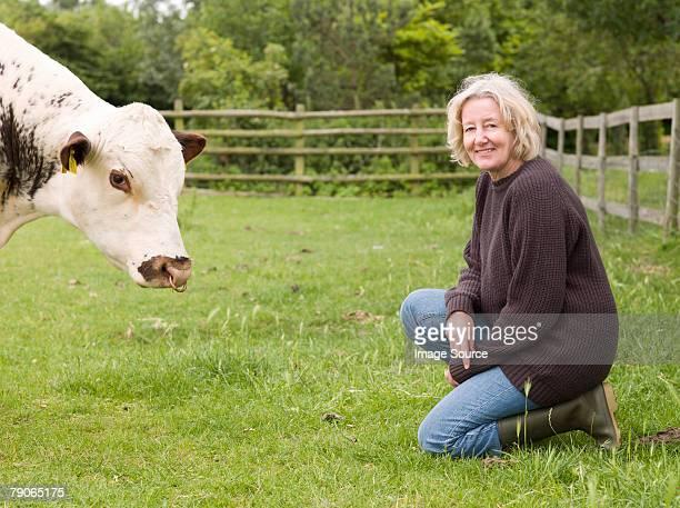 A farmer with a cow