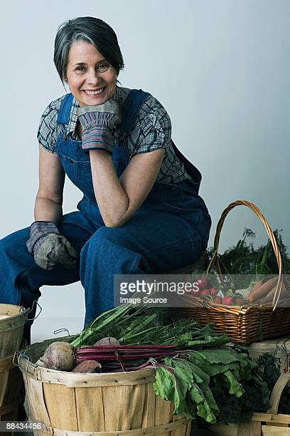 Farmer with baskets of vegetables