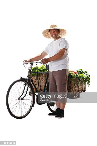 Farmer with bicycle and vegetables