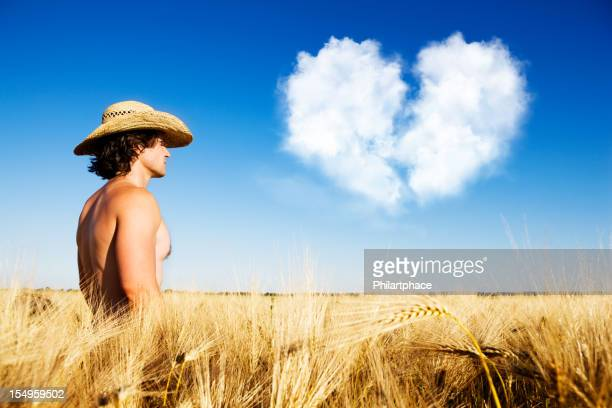 farmer with heartache in grain field