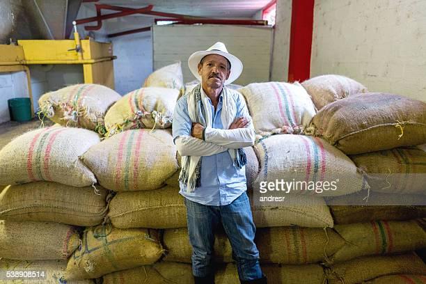 Farmer with sacks of Colombian coffee