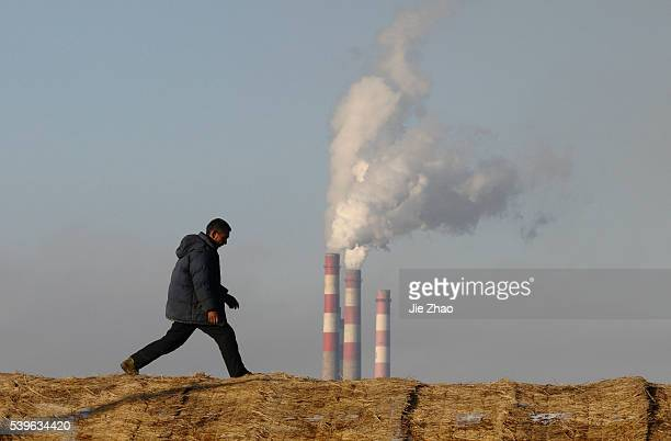 A farmer works on his greenhouse near a heat power plant in Changzhi Shanxi province December 21 2009 UN climate talks ended with a bareminimum...