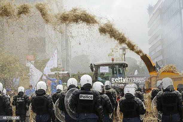 Farmers and antiriot policemen clash during a demonstration in front of the European Commission building on September 7 in Brussels as European...