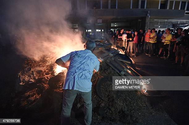 Farmers and breeders set fire to manure tyres and wooden pallets they dumped outside the prefecture building in downton Rennes northwestern France on...