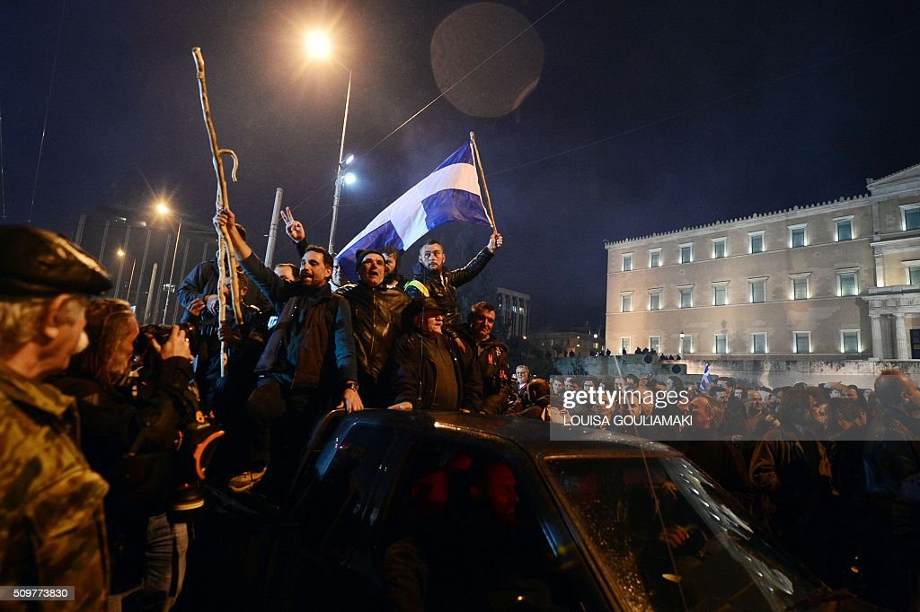Farmers and priests arrive on tractors and vehicles in front of the Greek parliament in Athens during a rally against pension reform, on February 12, 2016. Fears that Greece will exit the eurozone, a 'Grexit', could revive if Greek authorities do not come up with 'credible' reforms, notably on pensions, a senior IMF official said February 11. / AFP / LOUISA GOULIAMAKI