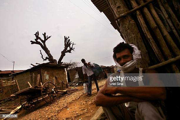 Farmers are pictured on April 2008 in the village of Bhad Umri in the Vidarbha region of Maharashtra state India A wave of farmers' suicides has hit...