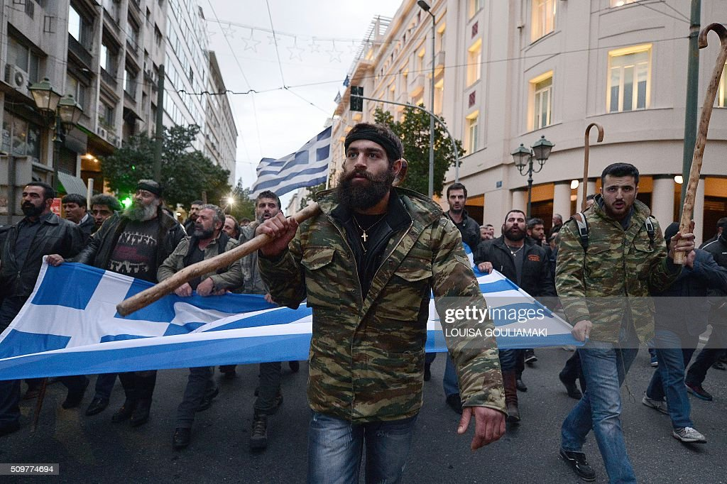 Farmers arrive in front of the Greek parliament in Athens during their rally against pension reform, on February 12, 2016 Fears that Greece will exit the eurozone, a 'Grexit', could revive if Greek authorities do not come up with 'credible' reforms, notably on pensions, a senior IMF official said February 11. / AFP / LOUISA GOULIAMAKI